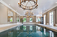 BNPS.co.uk (01202 558833)<br /> Pic: Savills/BNPS<br /> <br /> Pictured: The indoor pool complex.<br /> <br /> A striking turreted French style chateau in one of the UK's most desirable streets is on the market for £9.25m.<br /> <br /> Deauville is an impressive mansion with a striking period exterior but a stylish contemporary look inside and all the mod cons a home owner would want, including an indoor pool complex and cinema room.<br /> <br /> The house is in the prestigious St George's Hill estate in Weybridge, Surrey, which is renowned all over the world.<br /> <br /> The five-bedroom house was built in 2000 but has undergone an extensive refurbishment in the last few years.