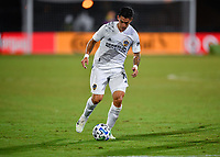 LAKE BUENA VISTA, FL - JULY 18: Cristian Pavón #10 of LA Galaxy dribbles the ball during a game between Los Angeles Galaxy and Los Angeles FC at ESPN Wide World of Sports on July 18, 2020 in Lake Buena Vista, Florida.