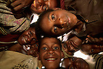 Children crowd around to be photographed, Papua New Guinea