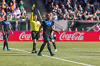 Portland, Oregon - Sunday October 6, 2019: Judson #93 is shown a yellow card by referee, Rubiel Vazquez, during a regular season match between Portland Timbers and San Jose Earthquakes at Providence Park in Portland, Oregon.