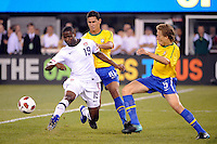 Maurice Edu (19) of the United States passes the ball away from Paulo Henrique Ganso (10) and Lucas (5)  of Brazil. The men's national team of Brazil (BRA) defaeted the United States (USA) 2-0 during an international friendly at the New Meadowlands Stadium in East Rutherford, NJ, on August 10, 2010.