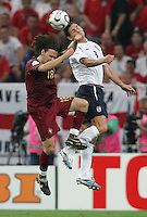 Portuguese midfielder (18) Maniche goes up for a header against English midfielder (8) Frank Lampard.  Portugal defeated England on penalty kicks after playing to a 0-0 tie in regulation in their FIFA World Cup quarterfinal match at FIFA World Cup Stadium in Gelsenkirchen, Germany, July 1, 2006.