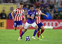 Orlando, FL - Wednesday July 31, 2019:  Carlos Vela #10, Rodrigo Riquelme #32 during the Major League Soccer (MLS) All-Star match between the MLS All-Stars and Atletico Madrid at Exploria Stadium.