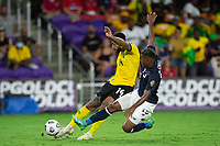 ORLANDO, FL - JULY 20: Andre Gray #14 of Jamaica kicks the ball during a game between Costa Rica and Jamaica at Exploria Stadium on July 20, 2021 in Orlando, Florida.