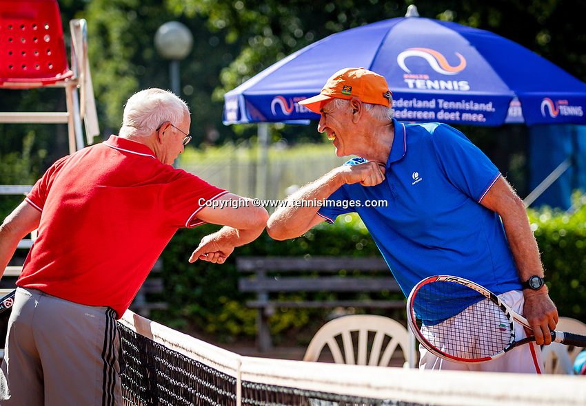 Hilversum, The Netherlands,  August 18, 2020,  Tulip Tennis Center, NKS, National Senior Championships, Men's single 70+ ,  Frank van Lerven (NED) (R) is congratulated in Corona style by Gerard Gerritsen (NED) with elbows.<br /> Photo: www.tennisimages.com/Henk Koster