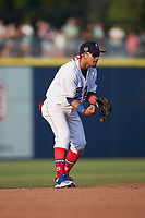 Kannapolis Cannon Ballers shortstop Jose Rodriguez (12) on defense against the Charleston RiverDogs at Atrium Health Ballpark on July 4, 2021 in Kannapolis, North Carolina. (Brian Westerholt/Four Seam Images)