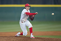 Belmont Abbey Crusaders starting pitcher Cameron Busby (9) delivers a pitch to the plate against the Catawba Indians at Abbey Yard on February 7, 2017 in Belmont, North Carolina.  The Crusaders defeated the Indians 12-9.  (Brian Westerholt/Four Seam Images)