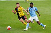 Tom Cleverley of Watford and Raheem Sterling of Man City during the Premier League match between Watford and Manchester City at Vicarage Road, Watford, England on 21 July 2020. Football Stadiums around remain empty due to the Covid-19 Pandemic as Government social distancing laws prohibit supporters inside venues resulting in all fixtures being played behind closed doors until further notice.<br /> Photo by Andy Rowland.