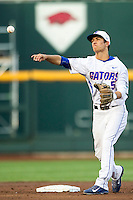 Florida Gators second baseman Dalton Guthrie (5) makes a throw to first base against the Miami Hurricanes in the NCAA College World Series on June 13, 2015 at TD Ameritrade Park in Omaha, Nebraska. Florida defeated Miami 15-3. (Andrew Woolley/Four Seam Images)