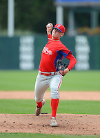 Pitcher Scott Blewett (18) of Baker High School in Baldwinsville, New York playing for the Philadelphia Phillies scout team during the East Coast Pro Showcase on August 1, 2013 at NBT Bank Stadium in Syracuse, New York. (Mike Janes/Four Seam Images)