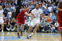 CHAPEL HILL, NC - FEBRUARY 25: Garrison Brooks #15 of the University of North Carolina is fouled by Jericole Hellems #4 of North Carolina State University during a game between NC State and North Carolina at Dean E. Smith Center on February 25, 2020 in Chapel Hill, North Carolina.