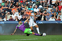 Jefferson Montero of Swansea City is tackled by Eros Pisano of Bristol City during the Sky Bet Championship match between Swansea City and Bristol City at the Liberty Stadium, Swansea, Wales, UK. Saturday 25 August 2018