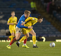 Fleetwood Town's Ched Evans (right) is tackled by Portsmouth's Cameron McGeehan (left) <br /> <br /> Photographer David Horton/CameraSport<br /> <br /> The EFL Sky Bet League One - Portsmouth v Fleetwood Town - Tuesday 10th March 2020 - Fratton Park - Portsmouth<br /> <br /> World Copyright © 2020 CameraSport. All rights reserved. 43 Linden Ave. Countesthorpe. Leicester. England. LE8 5PG - Tel: +44 (0) 116 277 4147 - admin@camerasport.com - www.camerasport.com