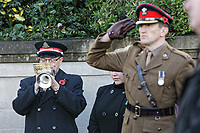 Pictured: A Salvation Army bugler marks the end of the minute's silence during the service. Sunday 11 November 2018<br /> Re: Commemoration for the 100 years since the end of the First World War on Remembrance Day at the Swansea Cenotaph in south Wales, UK.
