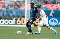 DENVER, CO - JUNE 3: Jordan Siebatcheu #16 of the United States moves with the ball during a game between Honduras and USMNT at EMPOWER FIELD AT MILE HIGH on June 3, 2021 in Denver, Colorado.