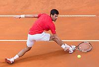 Il serbo Novak Djokovic in azione nel corso degli Internazionali d'Italia di tennis a Roma, 13 maggio 2016.<br /> Serbia's Novak Djokovic returns the ball to Spain's Rafael Nadal during the italian Open tennis in Rome, 13 May 2016.<br /> UPDATE IMAGES PRESS/Riccardo De Luca