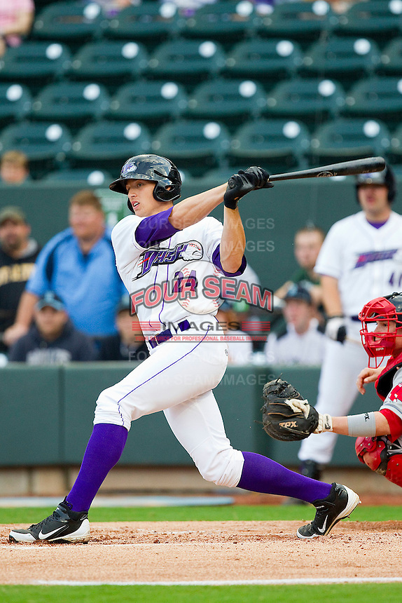 Trayce Thompson #24 of the Winston-Salem Dash follows through on his swing against the Salem Red Sox at BB&T Ballpark on May 5, 2012 in Winston-Salem, North Carolina.  The Red Sox defeated the Dash 6-4.  (Brian Westerholt/Four Seam Images)