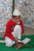 Madrasa Student Reading Koranic Selection in the Mosque, Madrasa Imdadul Uloom, Dehradun, India.