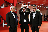 From left, Paolo Baratta, Lorenzo Vigas and Alberto Barbera attend the red carpet for the Winners of the 72nd Venice Film Festival at the Palazzo Del Cinema in Venice, Italy September 12, 2015.<br /> UPDATE IMAGES PRESS/Stephen Richie