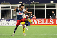 FOXBOROUGH, MA - MAY 16: DeJuan Jones #24 of New England Revolution intercepts a high ball during a game between Columbus SC and New England Revolution at Gillette Stadium on May 16, 2021 in Foxborough, Massachusetts.