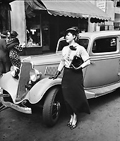 Fashion photo from 1935.<br /> female Model with car<br /> <br /> Photo by Harris & Ewing.