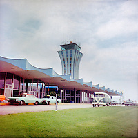 Vintage view of the taxi stand and a vintage VW Volkswagon Bus parked at the Robert Mueller Municipal Airport Control Tower in Austin, Texas on June 26, 1968 - Stock Image.