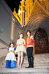 """July 18, 2012, Tokyo, Japan - (L-R) The child actress Tani Kanon, Lily Collins and the Japanese actor Daigo pose for the cameras outside the St. Grace Cathedral at the Premier of """"Mirror Mirror"""" in Tokyo. The """"Mirror Mirror"""" film tells the story of an orphaned princess called Snow White (Lilly Collins) and her cruel stepmother the Queen (Julia Roberts) who plans to take over the kingdom. The Queen tries to get rid of Snow White by throwing the forest, but princess is rescued by a band of diminutive highway robbers, and with them she seeks to recover her kingdom. This film will be released from September 14 in Japan. (Photo by Rodrigo Reyes Marin/AFLO)"""