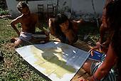Chapada dos Guimaraes, Mato Grosso, Brazil. Liz Hosken, Mario Friedlander and Jorge looking at a map of Brazil; 1990.