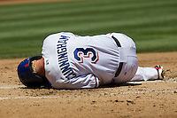Round Rock outfielder Aaron Cunningham (3) lays on the ground after fouling a pitch off his foot against the Nashville Sounds in the Pacific Coast League baseball game on May 5, 2013 at the Dell Diamond in Round Rock, Texas. Round Rock defeated Nashville 5-1. (Andrew Woolley/Four Seam Images).