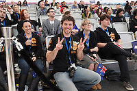 MELBOURNE, 18 MAY 2014 - Supporters of Rie Moustakas from Australia cheers her on in the final of the 2014 World Latte Art Championship at the Melbourne Show Grounds in Melbourne, Australia. Christian Ullrich of Germany won the championship from Chiara Bergonzi of Italy and Edit Juhasz of Hungary. Photo Sydney Low /  asteriskimages.com