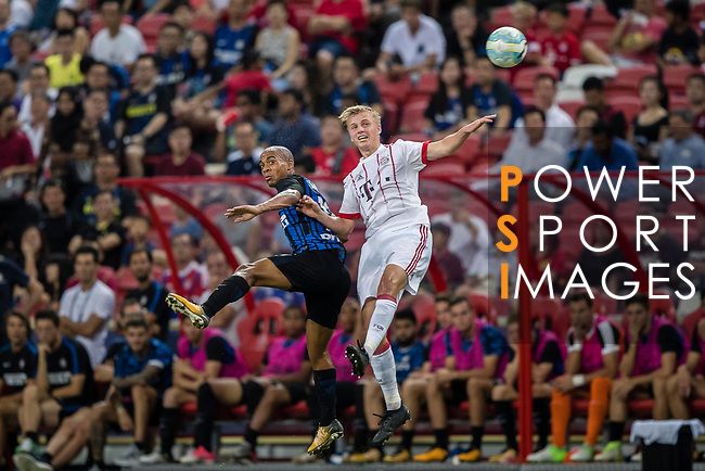 FC Internazionale Midfielder Joao Mario (L) fights for the ball with Bayern Munich Defender Felix Gotze (R) during the International Champions Cup match between FC Bayern and FC Internazionale at National Stadium on July 27, 2017 in Singapore. Photo by Marcio Rodrigo Machado / Power Sport Images