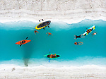 Paddle boarders and kayakers make their way through the vibrant blue melt waters by Matt Newey