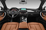 Stock photo of straight dashboard view of 2016 BMW 3 Series M Sport 5 Door Wagon Dashboard