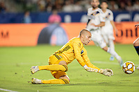 CARSON, CA - SEPTEMBER 21: Evan Bush #1 of the Montreal Impact makes a save during a game between Montreal Impact and Los Angeles Galaxy at Dignity Health Sports Park on September 21, 2019 in Carson, California.