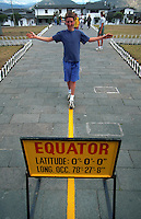 Boy walks on a line indicating the equator.
