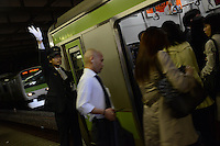 Passengers make their way onto a train in Shinjuku Station, Tokyo, Japan during morning rush-hour. With up to 4 million passengers passing through it every day, Shinjuku station, Tokyo, Japan, is the busiest train station in the world. The station was used by an average of 3.64 million people per day.  That's 1.3 billion a year.  Or a fifth of humanity. Shinjuku has 36 platforms, and connects 12 different subway and railway lines.  Morning rush hour is pandemonium with all trains 200% full. <br /> <br /> Photo by Richard Jones / sinopix