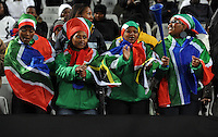 Local fans dressed in South African flags dance before the match. USA defeated Spain 2-0 during the semi-finals of the FIFA Confederations Cup at Free State Stadium in Manguang/Bloemfontein, South Africa on June 24, 2009..