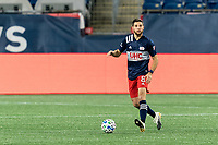 FOXBOROUGH, MA - NOVEMBER 20: Matt Polster #8 of New England Revolution looks to pass during Audi 2020 MLS Cup Playoffs, Eastern Conference Play-In Round game between Montreal Impact and New England Revolution at Gillette Stadium on November 20, 2020 in Foxborough, Massachusetts.