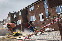 High Wycombe, UK. 16th April, 2020.<br /> Builders work on a house during the Covid-19 Pandemic as the UK Government advice to maintain social distancing and minimise time outside in High Wycombe on 16 April 2020. Photo by PRiME Media Images