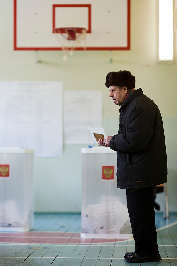 Moscow, Russia, 04/03/2012..A man waits to register to vote on a basketball court as Russians vote in the Presidential election, which Prime Minister Vladimir Putin is expected to win in the first round.