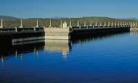 Elephant Butte Dam (completed 1916), and southern end of Elephant Butte Lake, a huge reservoir near Truth or Consequences, New Mexico. waterway, structure. New Mexico, Elephant Butte Dam.