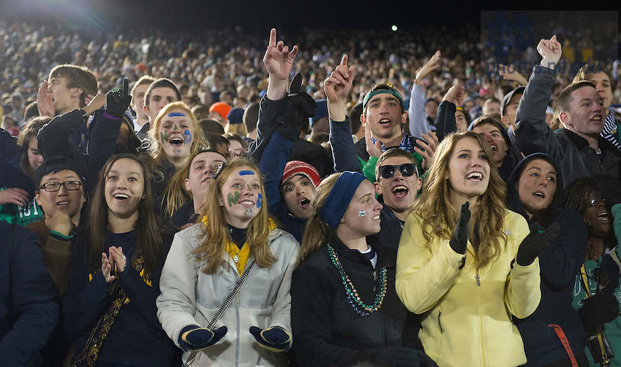 Nov. 3, 2012; Students rejoice after Notre Dame won 29-26 in triple overtime against Pittsburgh. Photo by Barbara Johnston/University of Notre Dame