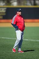 Richmond Spiders head coach Tracy Woodson coaches third base during the game against the Wake Forest Demon Deacons at David F. Couch Ballpark on March 6, 2016 in Winston-Salem, North Carolina.  The Demon Deacons defeated the Spiders 17-4.  (Brian Westerholt/Four Seam Images)