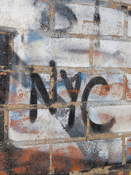 Detail of a Brick Wall with Graffiti Spelling Out 'NYC' , Mechanic's Alley, Chinatown/Lower East Side, Lower Manhattan, New York City, New York State, USA<br /> <br /> AVAILABLE FOR COMMERCIAL OR EDITORIAL LICENSING FROM GETTY IMAGES.  Please go to www.gettyimages.com and search for image # 151610472.<br /> <br /> AVAILABLE FROM JEFF AS A FINE ART PRINT.