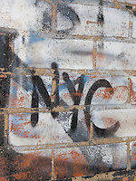 Detail of a Brick Wall with Graffiti Spelling Out 'NYC' , Mechanic's Alley, Chinatown/Lower East Side, Lower Manhattan, New York City, New York State, USA<br />