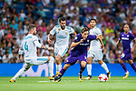 Federico Chiesa (r) of ACF Fiorentina runs past Sergio Ramos of Real Madrid during the Santiago Bernabeu Trophy 2017 match between Real Madrid and ACF Fiorentina at the Santiago Bernabeu Stadium on 23 August 2017 in Madrid, Spain. Photo by Diego Gonzalez / Power Sport Images