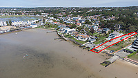 BNPS.co.uk (01202) 558833. <br /> Pic: CorinMesser/BNPS<br /> <br /> Pictured: The development site at Dorset Lake Avenue in Poole, Dorset opens onto Poole Harbour. <br /> <br /> A wealthy homeowner has made the 'brave' decision to demolish his £6m seaside mansion that has its own indoor pool, gym and cinema. <br /> <br /> Ashley Faull has flattened the 20-year-old luxury house to build nine new flats to meet the increasing demand for housing that has led to a surge in property prices.<br /> <br /> The apartments will be priced between £1.495m to £2.8m.<br /> <br /> The now ruined four-storey and 19-room home sits on a half-an-acre plot that backs on to Poole Harbour and overlooks exclusive Sandbanks in Dorset.