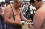 Derby Day, money changing hands offcourse gambling.  The English Season published by Pavilon Books 1987