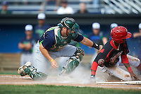 Vermont Lake Monsters catcher Nick Collins (20) tags out Anfernee Seymour (3) sliding into home during a game against the Batavia Muckdogs August 9, 2015 at Dwyer Stadium in Batavia, New York.  Vermont defeated Batavia 11-5.  (Mike Janes/Four Seam Images)