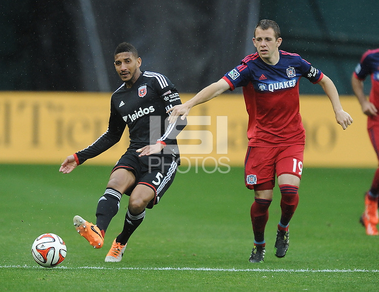 Washington, D.C.- March 29, 2014. Sean Franklin (5) of D.C. United goes against Harry Shipp of the Chicago Fire. The Chicago Fire tied D.C. United 2-2 during a Major League Soccer Match for the 2014 season at RFK Stadium.
